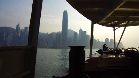 Establishing-shot-from-the-ferry-boat-reveals-Hong-Kong-harbor-and-skyline-with-clouds-3