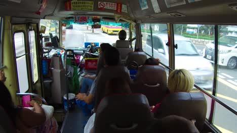 POV-shot-looking-out-of-a-Chinese-bus-moving-through-Hong-Kong-China