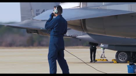 American-Fighter-Jets-Are-Inspected-On-The-Runway-By-Air-Force-Personnel-Before-A-Mission