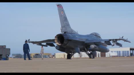 American-Fighter-Jets-Are-Inspected-On-The-Runway-By-Air-Force-Personnel-Before-A-Mission-1