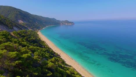 Aerial-over-beautiful-blue-Mediterranean-ocean-waters-reveals-Greek-Island-of-Lefkada-1