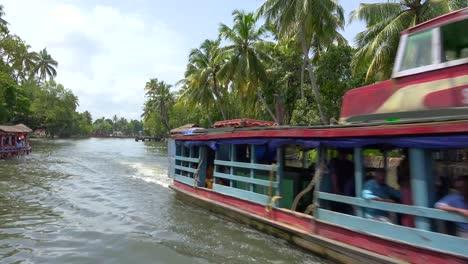 Houseboats-and-activities-along-the-river-in-the-backwaters-of-Kerala-India-1