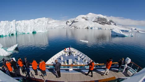 A-POV-time-lapse-shot-of-a-ship-bow-icebergs-and-tourists-passing-through-Andvord-Bay-Antarctica