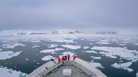 A-POV-time-lapse-shot-of-a-ship-bow-icebergs-and-tourists-passing-through-Cape-Fanshaw-Alaska