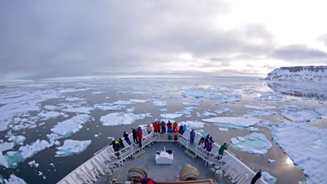A-POV-time-lapse-shot-of-a-ship-bow-icebergs-and-tourists-passing-through-Cape-Fanshaw-Alaska-1