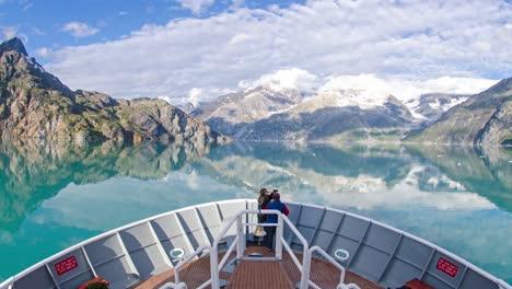 A-POV-time-lapse-shot-of-a-ship-bow-icebergs-and-tourists-passing-through-Johns-Hopkins-Glacier-Alaska