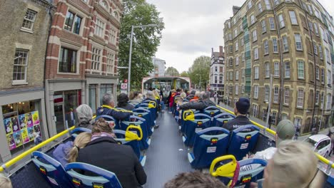 Time-lapse-shot-from-the-upper-deck-of-a-double-decker-open-air-bus-in-London