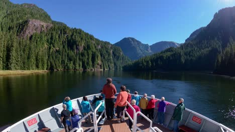 A-POV-time-lapse-shot-of-a-ship-bow-tourists-fjords-and-nature-passing-Misty-Fjords-Alaska