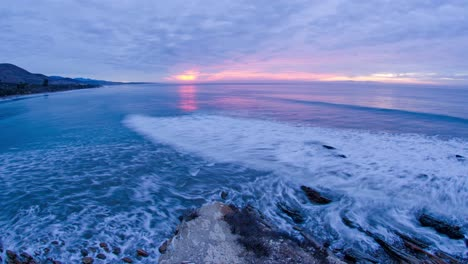 Timelapse-of-the-sun-rising-over-the-breaking-waves-at-Refugio-State-Beach-at-Gaviota-near-Santa-Barbara-California