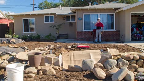 Timelapse-of-a-man-building-a-rock-wall-in-front-of-a-house-in-Oak-View-California