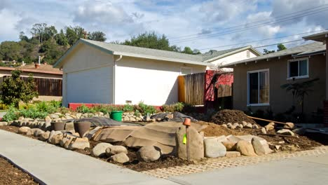 Timelapse-of-a-man-building-a-rock-wall-in-front-of-a-house-in-Oak-View-California-1