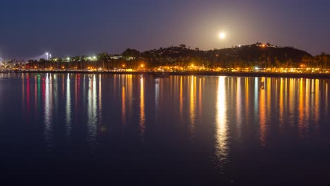 Timelapse-of-a-full-moon-setting-and-boats-leaving-the-Santa-Barbara-Harbor-at-sunrise-in-Santa-Barbara-California