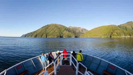 POV-timelapse-of-a-ship-entering-a-glassy-Gut-Bay-at-South-Baranof-Wilderness-in-Southeast-Alaska