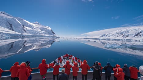 POV-Timelapse-of-ship-bow-and-ice-in-the-Gullet-slow-Antarctica-with-tourists-foreground