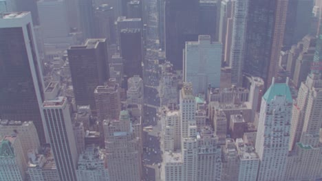 Helicopter-aerials-of-New-York-City-Manhattan-skyline-and-down-to-congested-streets