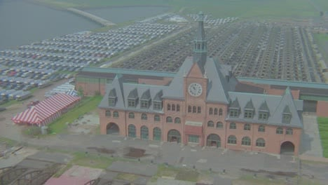 Helicopter-aerial-over-closed-Ellis-Island-Central-New-Jersey-Railroad-building-now-abandoned