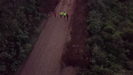 Aerial-over-Kenya-runners-and-olympic-athletes-training-on-a-dirt-road-in-Ngong-Hills-Nairobi-Kenya-1