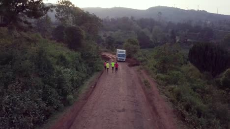 Aerial-over-Kenya-runners-and-olympic-athletes-training-on-a-dirt-road-in-Ngong-Hills-Nairobi-Kenya-2
