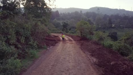 Aerial-over-Kenya-runners-and-olympic-athletes-training-on-a-dirt-road-in-Ngong-Hills-Nairobi-Kenya-4