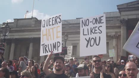 Protestors-Hold-Signs-Saying-Queers-Hate-Trump-And-No-One-Likes-You-During-A-Mass-Protest-On-The-Streets-Of-London-To-Protest-The-Visit-Of-US-President-Donald-Trump