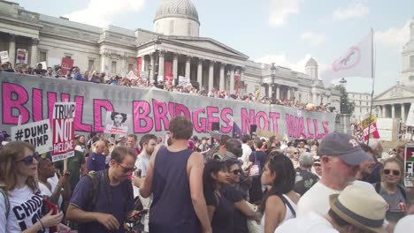Huge-Signs-Saying-Build-Bridges-Not-Walls-As-Crowds-Of-Protestors-Take-To-The-Streets-Of-London-England-To-Protest-The-Visit-Of-US-President-Donald-Trump
