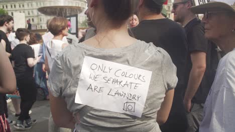 A-Protestor-Wears-A-Sign-Saying-The-Only-Colors-We-Separate-Are-Laundry-During-Massive-Protests-On-The-Streets-Of-London-England-To-Protest-Donald-Trump