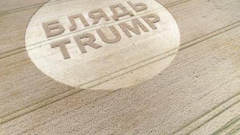 -Aerial-shots-of-a-crop-circle-in-the-United-Kingdom-England-with-writing-about-Trump