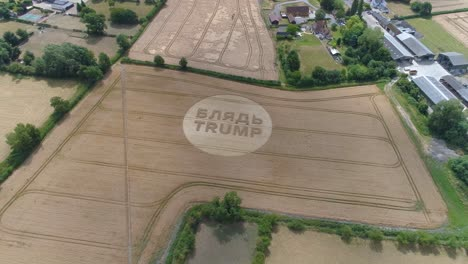 -Aerial-shots-of-a-crop-circle-in-the-United-Kingdom-England-with-writing-about-Trump-2