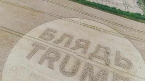 -Aerial-shots-of-a-crop-circle-in-the-United-Kingdom-England-with-writing-about-Trump-4
