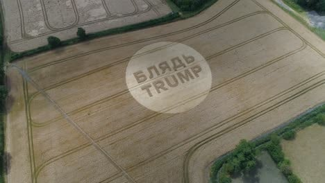 -Aerial-shots-of-a-crop-circle-in-the-United-Kingdom-England-with-writing-about-Trump-5