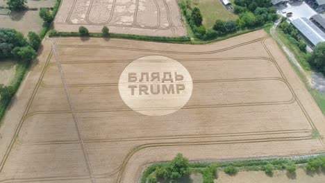 -Aerial-shots-of-a-crop-circle-in-the-United-Kingdom-England-with-writing-about-Trump-9