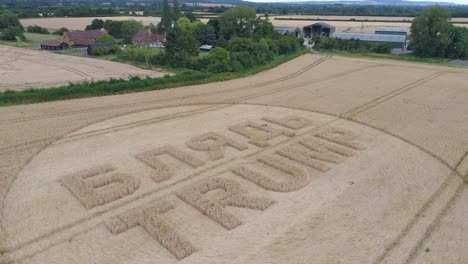 -Aerial-shots-of-a-crop-circle-in-the-United-Kingdom-England-with-writing-about-Trump-11