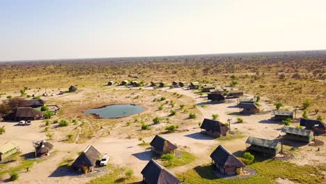 Nice-aerial-over-a-safari-lodge-around-a-watering-hole-at-Chobe-National-Park-Botswana-Africa-4