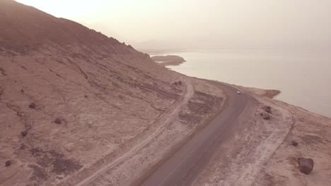 Good-aerial-above-a-pickup-truck-driving-on-a-coastal-road-in-Somalia-or-Djibouti-2