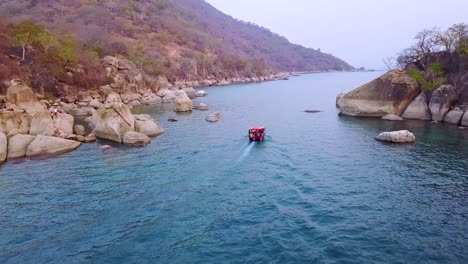 Aerial-over-a-small-dive-tour-boat-filled-with-tourists-off-the-coast-of-Monkey-Bay-Malawi-1