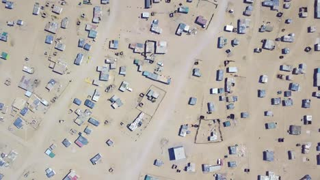 Vista-Aérea-over-a-strange-abandoned-town-of-empty-lonely-suburban-tract-houses-in-the-desert-of-Namibia-Africa-4