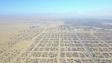 Vista-Aérea-over-a-strange-abandoned-town-of-empty-lonely-suburban-tract-houses-in-the-desert-of-Namibia-Africa-5