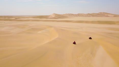 Good-aerials-over-ATV-vehicles-speeding-across-the-desert-sand-dunes-in-Namibia-Africa