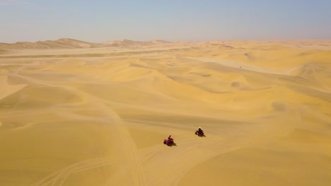 Good-aerials-over-ATV-vehicles-speeding-across-the-desert-sand-dunes-in-Namibia-Africa-1