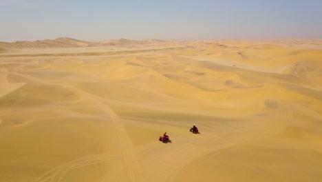 Good-aerials-over-ATV-vehicles-speeding-across-the-desert-sand-dunes-in-Namibia-Africa-1