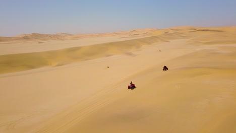 Good-aerials-over-ATV-vehicles-speeding-across-the-desert-sand-dunes-in-Namibia-Africa-2
