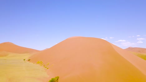 Aerial-over-rugged-desert-landscape-and-sand-dunes-near-Dune-45-in-Namibia-Africa