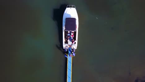 Aerial-over-a-small-dive-tour-boat-filled-with-tourists-off-the-coast-of-Namibia