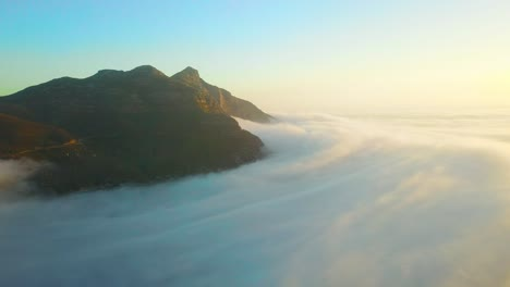 Drone-aerial-above-the-clouds-looking-at-Table-Mountain-and-Twelve-Apostles-behind-Cape-Town-South-Africa-1