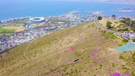 Drone-aerial-over-paragliding-and-paragliders-with-the-downtown-city-of-Cape-Town-South-Africa-in-background-4