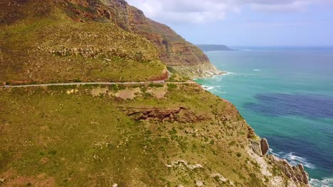 Aerial-of-the-beautiful-coastline-and-narrow-roads-south-of-Cape-Town-South-Africa-1