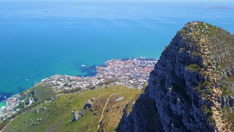 Aerial-shot-over-the-top-of-Lion-s-Head-mountain-peak-reveals-Cape-Town-South-Africa