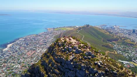 Aerial-shot-over-the-top-of-Lion-s-Head-mountain-peak-reveals-Cape-Town-South-Africa-1
