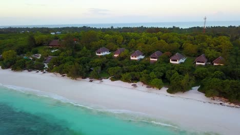 Aerial-drone-shot-over-tropical-resort-cabins-and-hotel-rooms-in-Tanzania-Africa