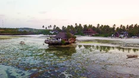 A-small-hut-restaurant-or-bar-on-a-beach-near-Stonetown-Zanzibar-Africa-1